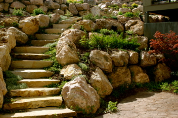 Stone stairs with stone retaining wall