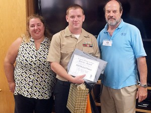 PO2 Michael Denney receives KBG Service Award (and appreciation goodies) as Junior Sailor of the Quarter.