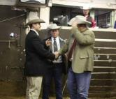 Lynn Langvardt accepts the Livestock Championship for 2010.