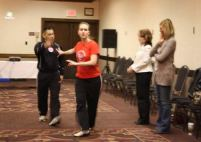 Chris Rangle presents his Girl2Girl Defense class to several women at the KAA-KAAA Convention. A few simple steps can provide protection.