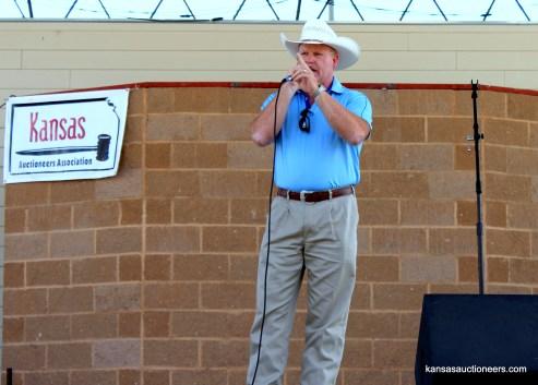 2015 Kansas Auctioneer Championship finals judge, Jason Winter, sells an item.