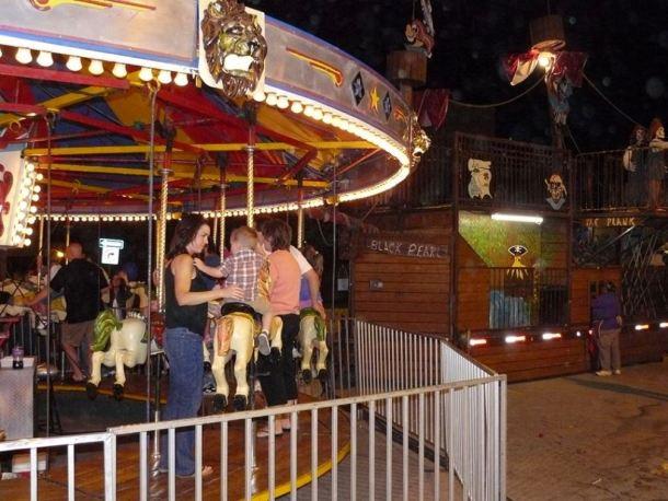 Kansas City Fall Festivals - kids on a carousel at Liberty Fall Festival