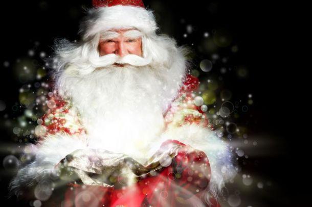Visits and photos with Santa in Kansas City - Santa looking inside his red bag