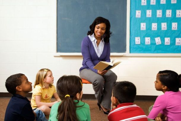 Science City Teacher Appreciation Weekend - teacher reading to students