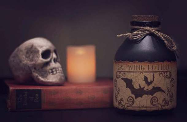 Kansas City Halloween Parties and Events for Adults - Skull, candle and bottle of bat potion
