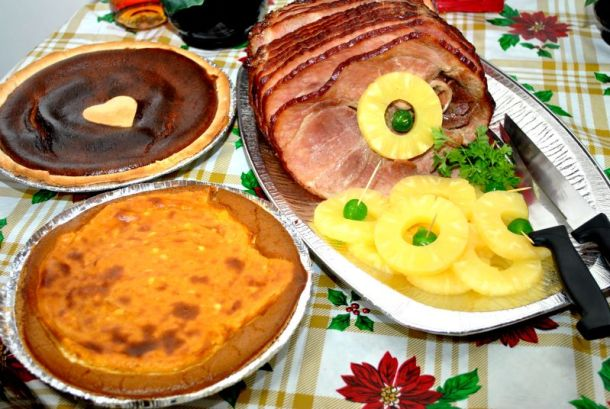 Holiday meals to-go in Kansas City - ham with pineapple, pie and sweet potatoes on a table
