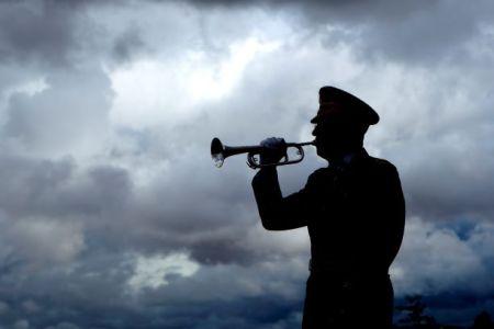Bugle player playing Taps