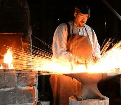 Westport Lost Arts Fair - man doing blacksmith work