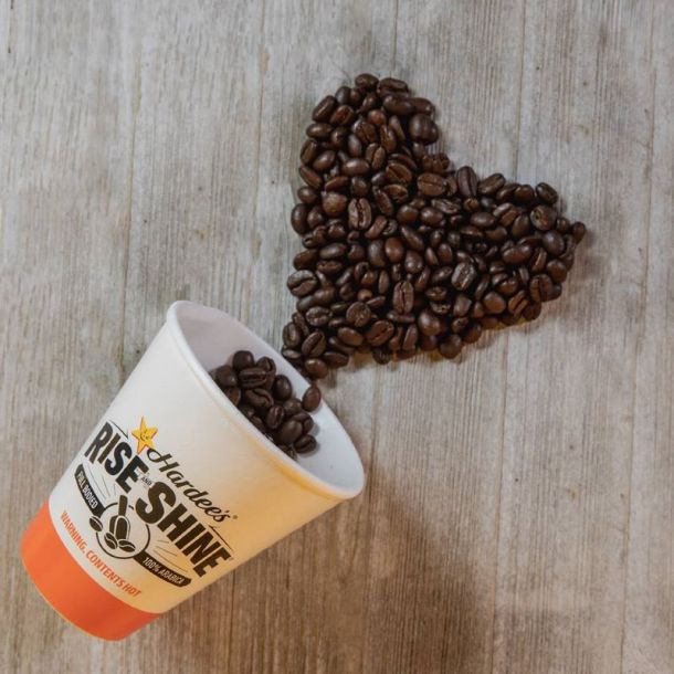 Hardee's coffee cup with coffee beans