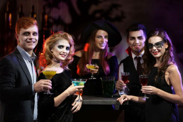 Free and Cheap Kansas City Halloween Parties and Events for Adults - young people in Halloween costumes holding drinks