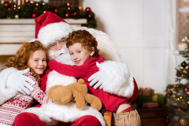 Photos with Santa in Kansas City - Santa with two young kids on his lap