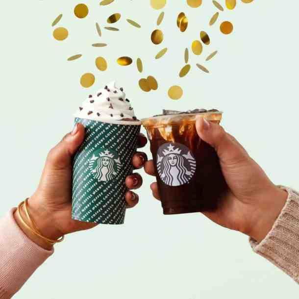 Starbucks pop-up parties in Kansas City - two Starbucks cups toasting