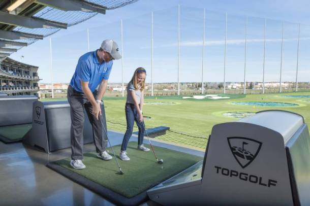 Weekly specials at Top Golf - dad and daughter playing golf