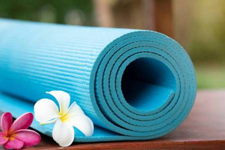 free and cheap yoga in Kansas City - rolled up yoga mat