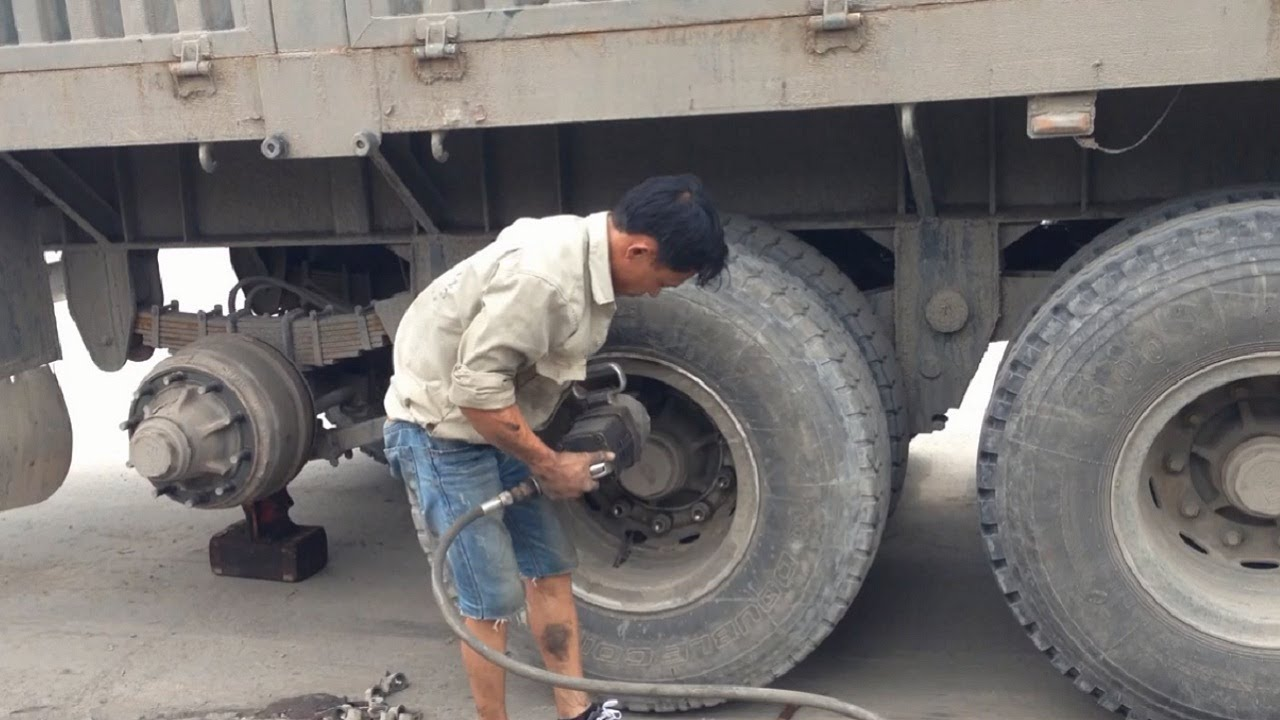 How To Repair Truck Tires - Fix a Flat Tire EASY - Nail In Tire Repair - Find Leak and Patch