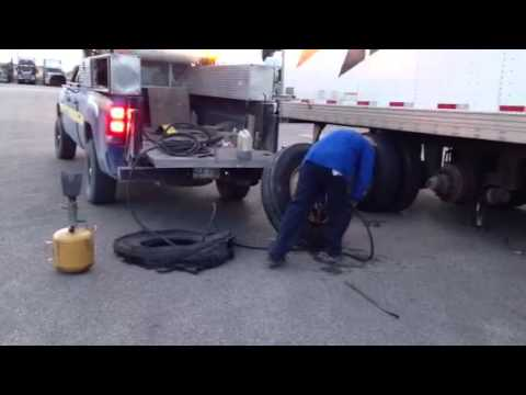 Pro tire repair on big rig