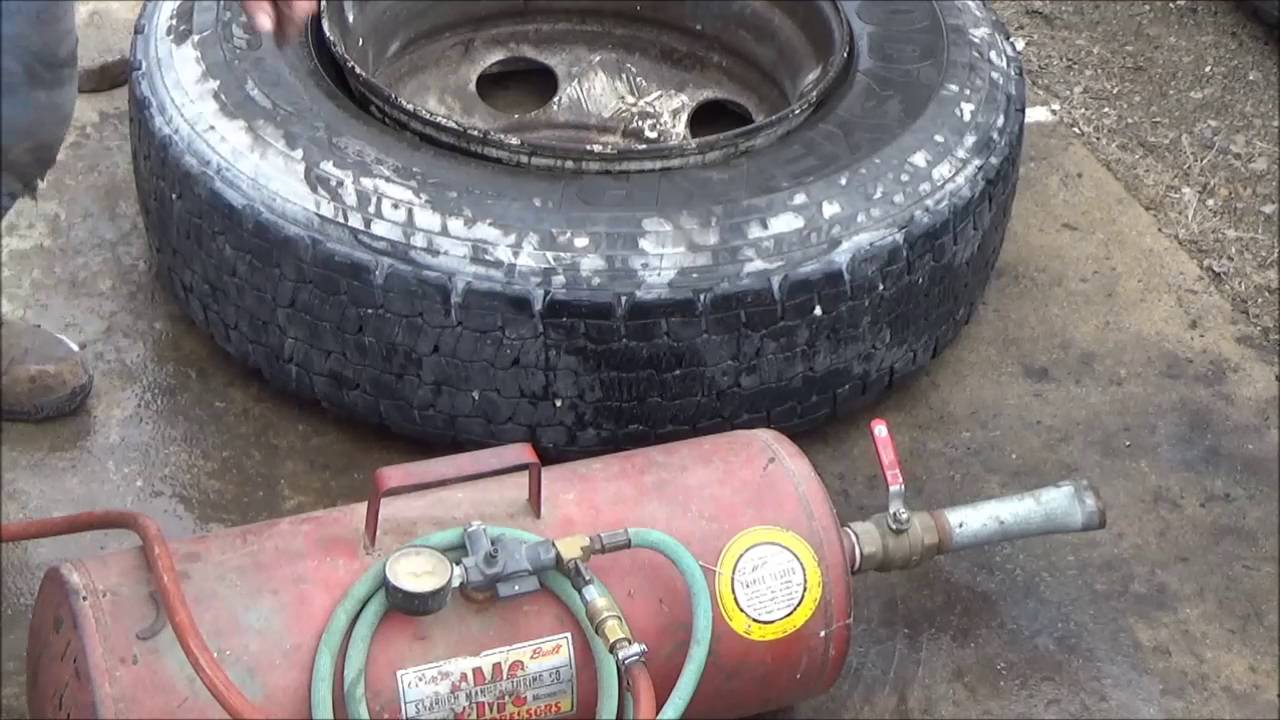 truck tire repair 3  When tire won't air up, wont seat, chain and binder trick.