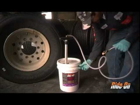 Commercial Tire installation using hand pump in Dual wheel assemblies