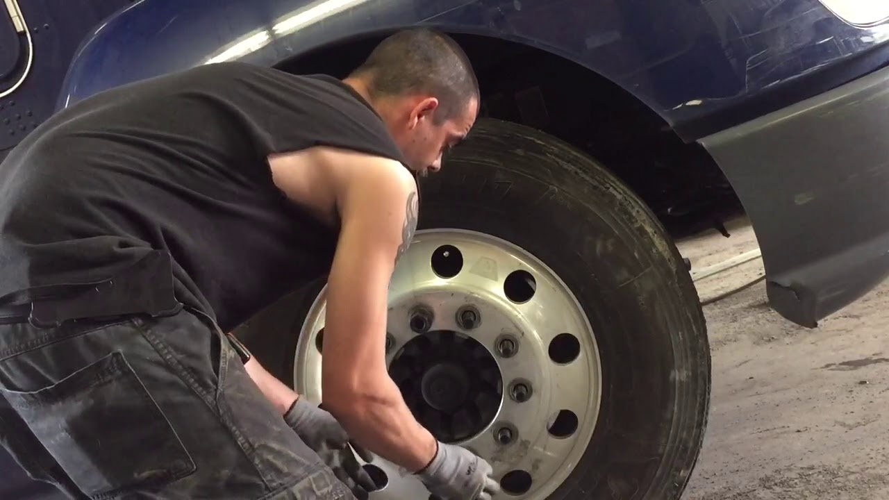 Me putting on a semi-truck tire