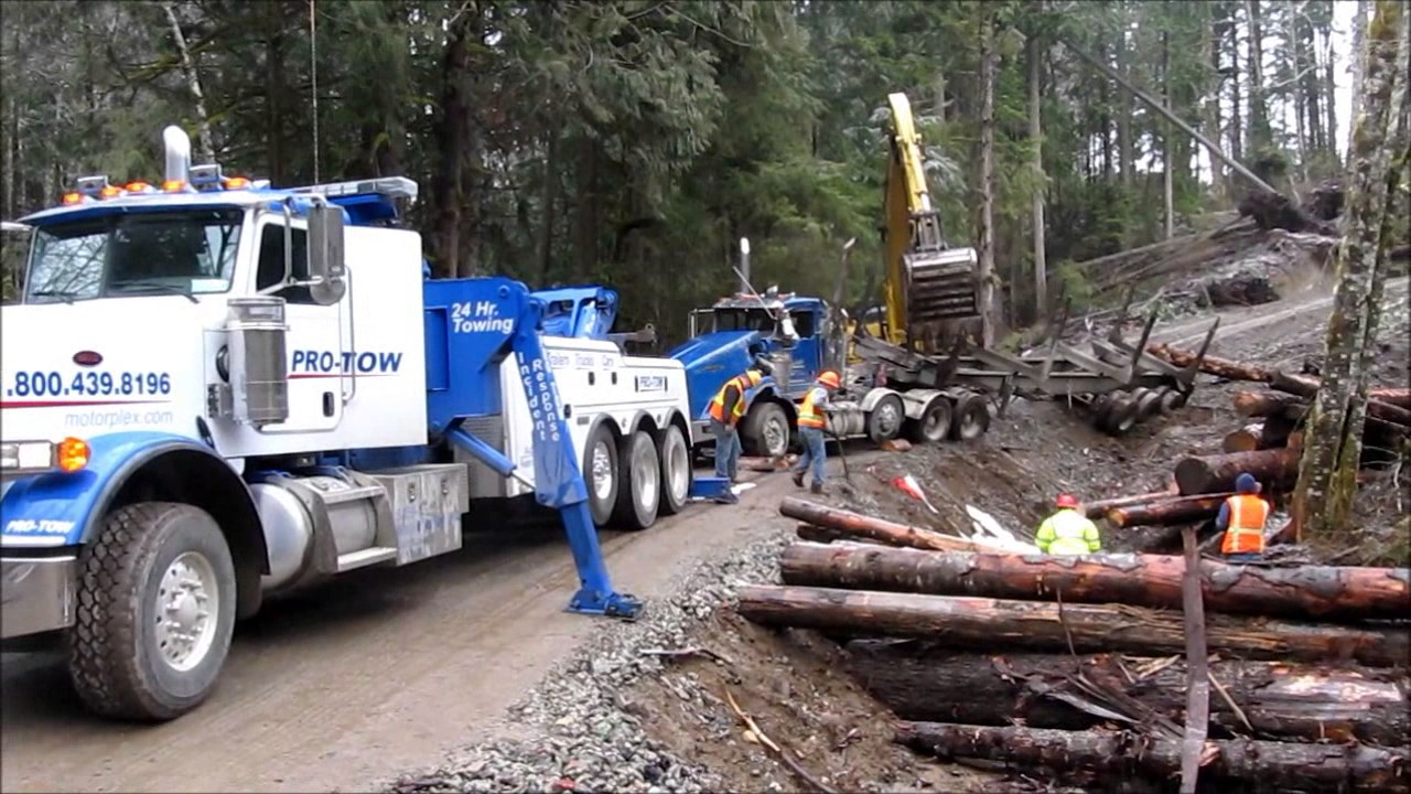 Log Truck Rolled Over and Uprighting
