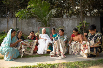 Surayia and some of the women of Arshi.  Photo copyright Anil Advani and Kantha Productions LLC.