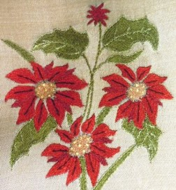 Poinsettias hand embroidered by women of Arshi.  Photo copyright Kantha Productions LLC.