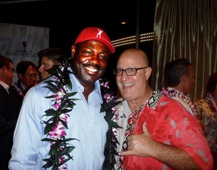 Kansas City Chiefs' Christian Okoye with guest – Itzel Contreras Mendez