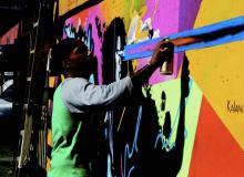 Oakland graffiti artist Kalani Ware working on his abstract mural at Pow! Wow! Hawai'i – Dutches K. Richards