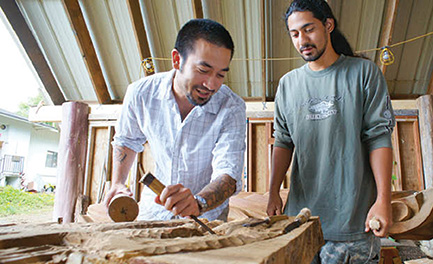Jordan Souza shows a WCC student the finer art of wood carving – Bonnie Beatson