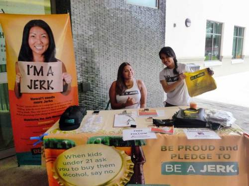 The 'Be a Jerk' table asked people to pledge not to buy alcohol for minors – Cynthia Lee Sinclair