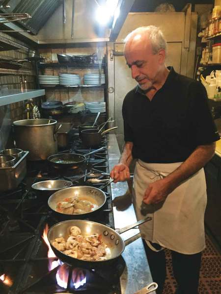 Chef Reza Azeri sautées clams for a dish called vongole. – Kristen Kumakura