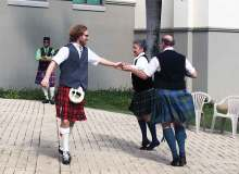 WCC IT specialist Michael McIntosh (left) participates in traditional Scottish dancing during IEW – Cynthia Lee Sinclair