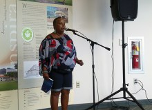 Feiruz Garrison recites her own poem at the Open Mic session in the library - Hannah Baily