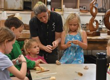 proChildren learn how to sand makau (fish hook necklaces) at Hale 'Iolani –Leighland Tagawa