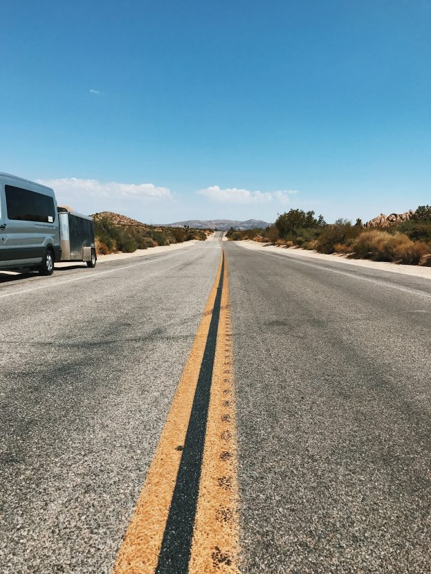 A long stretch of road with our van on the left - Joshua Tree National Park