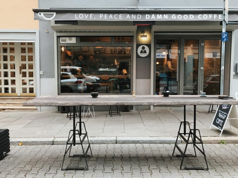 A cafe in Frankfurt with a standing table out the front.