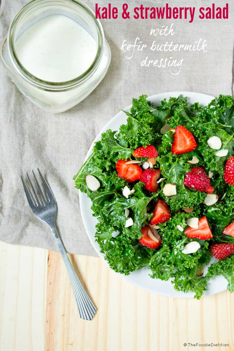 A delicious way to use kefir! Kale and strawberry salad with kefir buttermilk dressing is a great salad to bring to your next picnic or cookout! | @TheFoodieDietitian