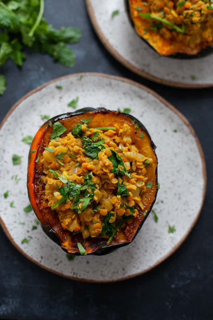 Packed with warming, cozy spices, this stuffed acorn squash with curried lentils is a perfect dinner for the chilly fall season.