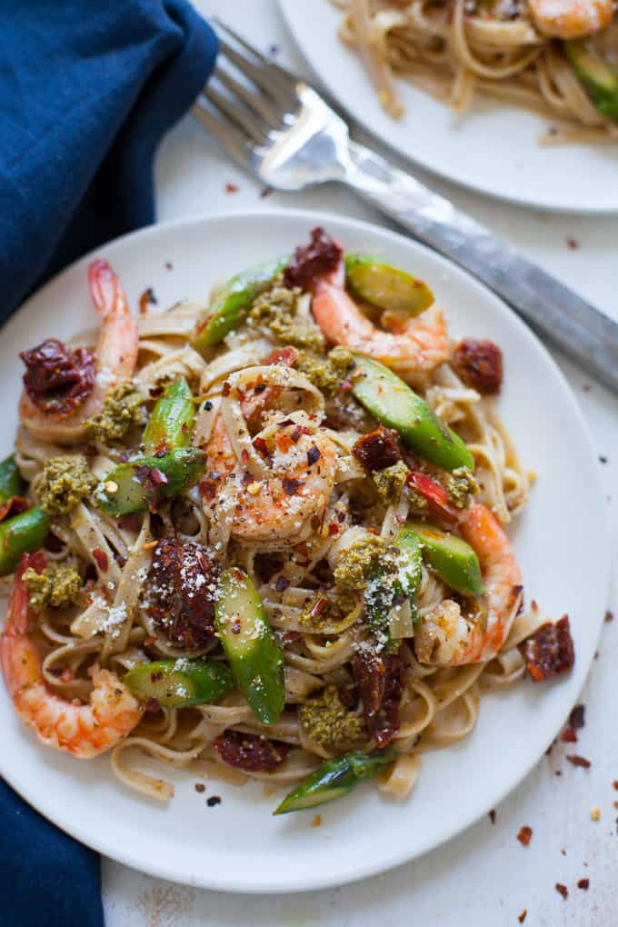 This easy shrimp pesto pasta with asparagus and sun-dried tomato is super easy to make for a quick weeknight dinner.