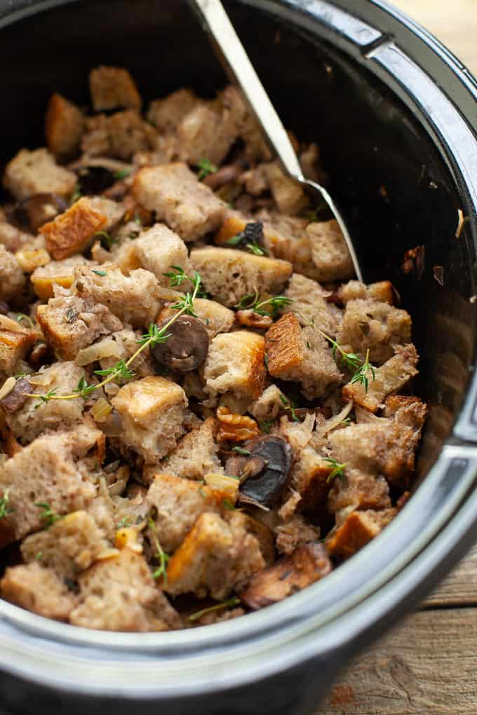 A delicious, savory, umami-filled side dish, this slow cooker mushroom stuffing will not take up any oven space on Thanksgiving! #thanksgiving #stuffing #mushrooms