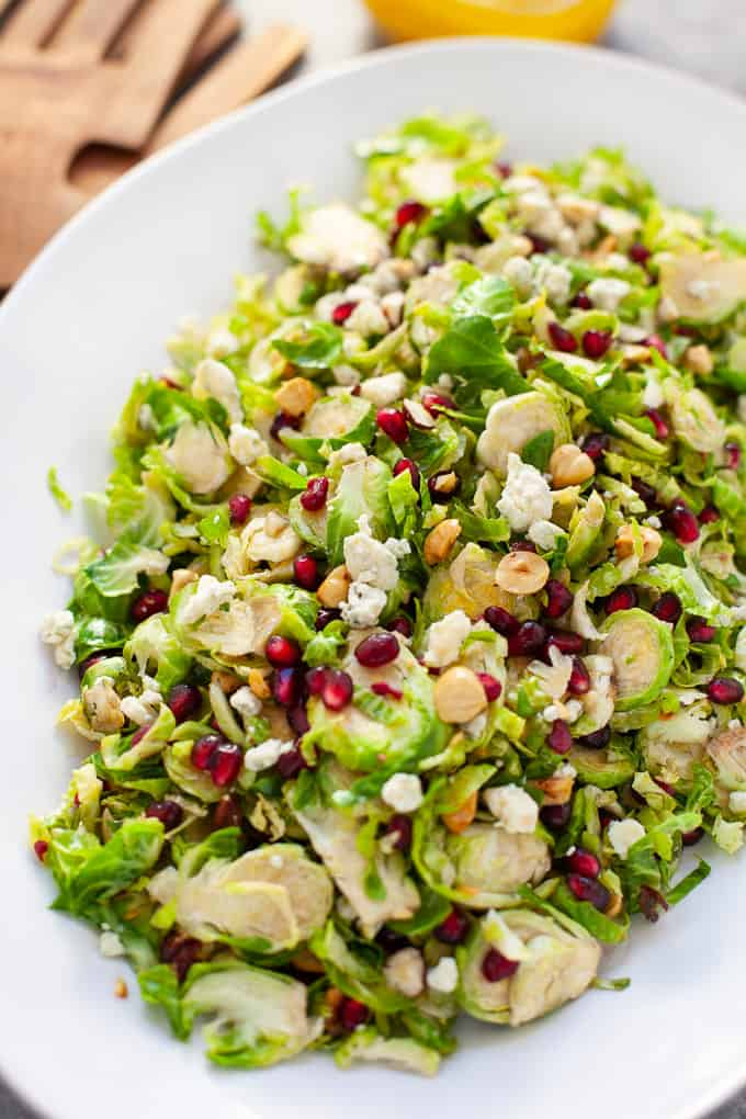 Looking for a festive salad to serve up this holiday season? You and your guests will love my easy and delicious shaved Brussels sprout salad with pomegranate with a citrus vinaigrette.