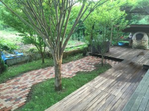The deck and bricks after being power washed. Almost like a new backyard.