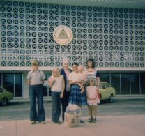 At the Managua airport, my brother Nathaniel, sister Jo, Grandma, someone I don't know holding me, my mom, and my sister Nic.