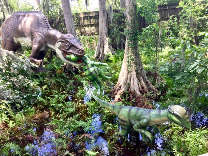 dinosaur eating dinosaur - wide shot