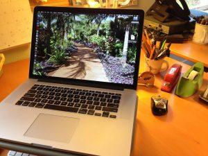 Apple Macbook Pro on writing desk