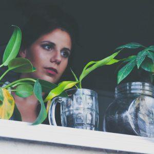 Woman Looking at Plants, Is Taking a Plant Break Really That Important? Karen Hugg, https://karenhugg.com/2021/02/14/taking-a-break/(opens in a new tab) #plants #stress #destressing #takingabreak #DanielLevitin #attentionrestoration #meditation #fivesteps #biophilia #dailystressreleaf