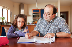 stock-photo-14979311-father-helping-daughter-with-her-homework
