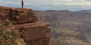 man standing at a canyon