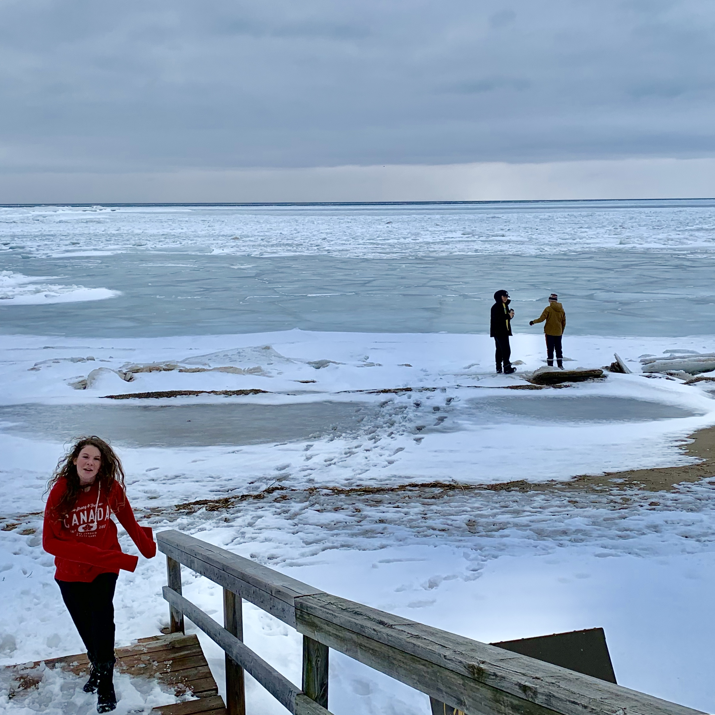kids at a frozen lake
