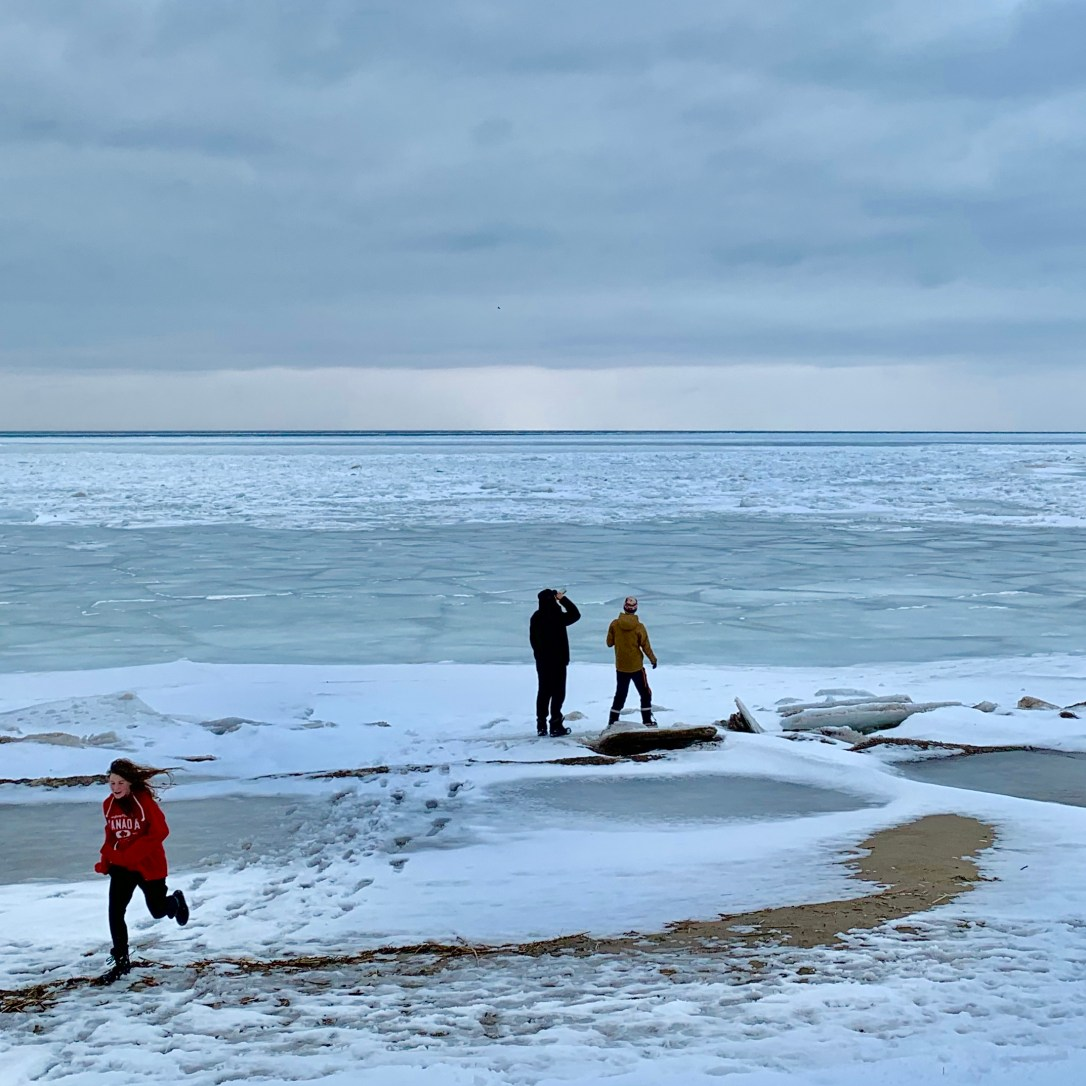 kids by a frozen lake